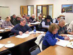 Figure 4: Photo of a classroom of adults reading papers