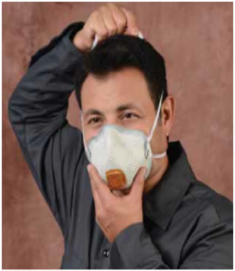 photo, man with respirator over his mouth