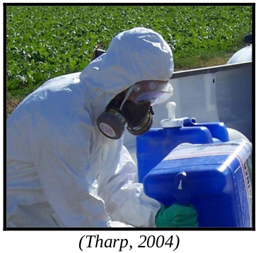 Person in full PPE suit with respirator. Caption: Tharp, 2004